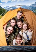 foto of tent  - Six scouts together inside the tent isolated traveling in the mountains - JPG