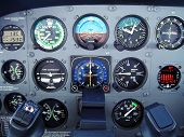 stock photo of cessna  - Small Cessna airplane instrument panel while flying at 8 - JPG