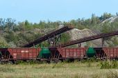 picture of iron ore  - The cars are awaiting loading stones rocks in a quarry for the extraction of iron ore - JPG