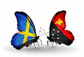 stock photo of papua new guinea  - Two butterflies with flags on wings as symbol of relations Sweden and Papua New Guinea - JPG