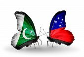 stock photo of samoa  - Two butterflies with flags on wings as symbol of relations Pakistan and Samoa - JPG