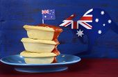 stock photo of meat icon  - Happy Australia Day January 26 party food with iconic meat pies and tomato sauce on dark red and blue vintage rustic recycled wood background - JPG