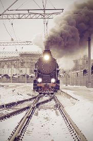 pic of train-wheel  - Retro steam train departs from the railway station at sunset - JPG