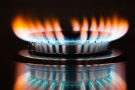 stock photo of grils  - Gas burning in the burner of gas oven - JPG