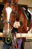 picture of caress  - Happy little boy caressing horse - JPG