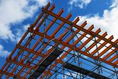 image of scaffold  - System of scaffolds against blue sky and clouds - JPG
