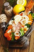 image of redfish  - Fried fish with vegetables in the pot - JPG