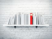 image of book-shelf  - Books on a shelf and one with idea cover - JPG