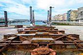 stock photo of machinery  - Detail of the old and rusty machinery a disused shipyard ramp - JPG