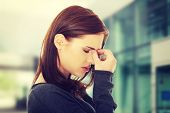 picture of sinuses  - Young woman with sinus pressure pain - JPG