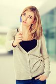 stock photo of pregnancy test  - Sad young woman holding pregnancy test - JPG