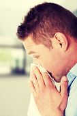 picture of blowing nose  - Sick young man blowing his nose - JPG
