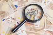 picture of fifties  - Closeup of fifty euro notes through magnifer background - JPG
