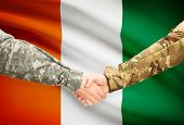 foto of coast guard  - Soldiers shaking hands with flag on background  - JPG