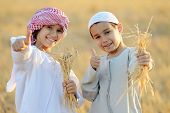 picture of muslim kids  - Kids on wheat field - JPG