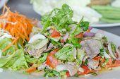 stock photo of thai cuisine  - Spicy salad of roasted beef Thai style cuisine - JPG