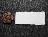 stock photo of coffee crop  - Coffee crop beans on leather texture background - JPG