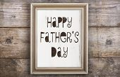 picture of backround  - Rectangle picture frame with Happy fathers day sign laid on wooden floor backround - JPG