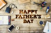 pic of happy day  - Office desk with Happy fathers day sign  - JPG