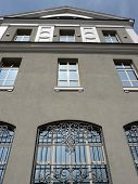 stock photo of grids  - windows of building with grid at sunny day - JPG