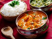 image of paneer  - Photo of an Indian meal of Butter Chicken rice and Saag Paneer - JPG