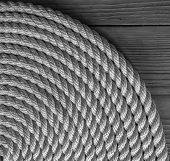 picture of coil  - Rope Coil on wooden desk - JPG