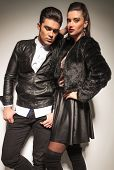 image of down jacket  - Attractive young fashion man looking down whlie his girlfriend is leaning on him - JPG