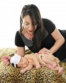 picture of adoration  - A loving mom adoring her newborn daughter who is sleeping contentedly on a leopard print blanket - JPG