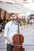 pic of cello  - The guy who plays the cello in the street in the summer - JPG