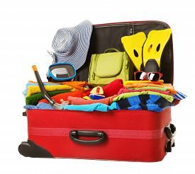 stock photo of packing  - Suitcase Packed to Vacation Open Red Luggage Full of Clothes Family Travel Items Baggage Trip Concept - JPG