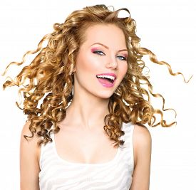 picture of hair blowing  - Beauty model girl with blowing Blonde curly hair - JPG