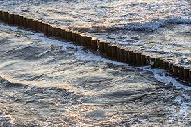 stock photo of breaker  - wave breakers at the ocean of the baltic sea - JPG