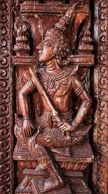 stock photo of mural  - Murals wood carvings a Buddhist temple in Thailand - JPG