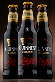 Постер, плакат: Three Bottles Of Guinness Beer