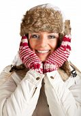 Caucasian blond woman in furry hat and christmas gifts isolated on white
