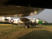 stock photo of b17  - b25 mitchell airplane taken from under the wing of a b17 at an airshow - JPG