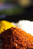 pic of mexican food  - chili in foreground curry and salt in blurred bokeh background - JPG