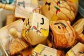 image of dreidel  - close up of hanukkah dreidels on market stand - JPG