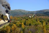 picture of yesteryear  - **Note slight blurriness, best at small size. cog train of yesteryear still in operation as it takes customers up the side of mount washington new hampshireon and early autumn day. - JPG