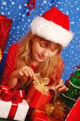 Girl And Christmas Gifts With Snowy Background