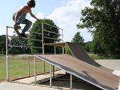 Teen Boy Skateboarding Outdoors poster