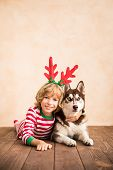 Happy Child And Dog On Christmas Eve poster