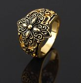 picture of vintage jewelry  - Vintage gold ring on black background  - JPG