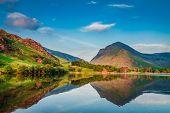 Beautiful Sunset At Lake In District Lake In Uk poster