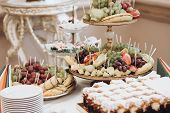 Delicious Fruits On Stand And Desserts Sweet On Table At Wedding Reception In Restaurant. Luxury Cat poster