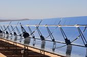 picture of thermal  - SEGS solar thermal energy electricity plant with parabolic mirrors concentrating the sunlight - JPG