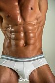 Closeup Body Underwear For Young Man. Unrecognizable Strong Bodybuilder With Six Pack. Bodybuilder M poster