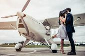 Couple Near Plane poster