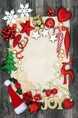 Christmas background border with joy sign, bauble decorations, mince pies, holly, mistletoe and foil poster