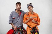 Two Female And Male Maintenance Workers Being Unwilling To Repair Kitchen Tube, Look With Uspet And poster